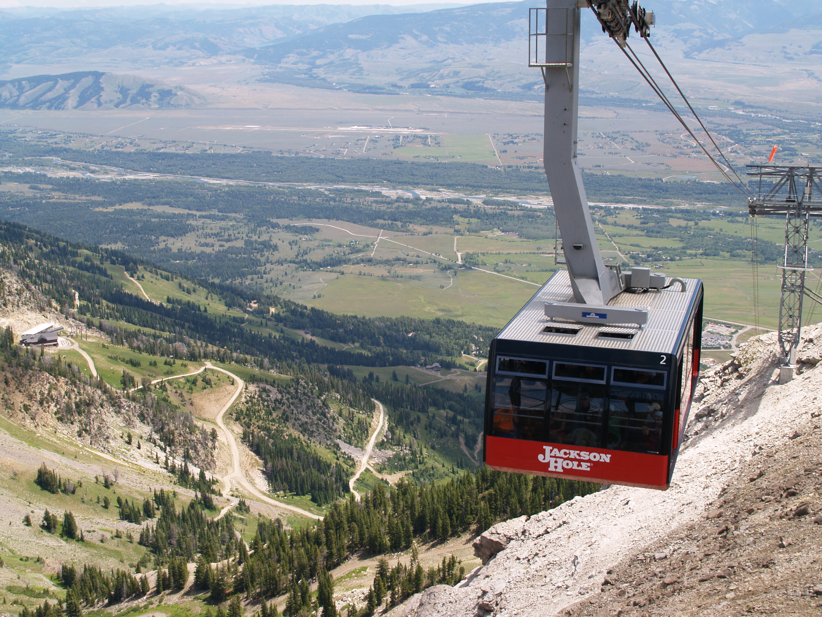 the tram arriving at the top of Rendezvous Mountain,Bridger Restaurant below on the far left